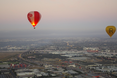 Balloons, city and sunrise