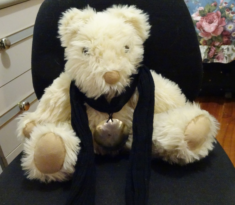 Bear wearing scarf
