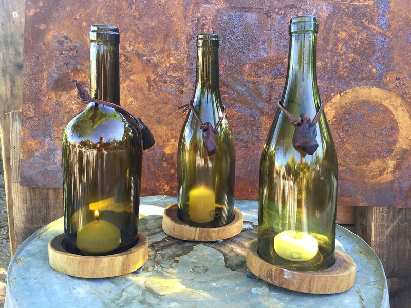 Candles in wine bottles