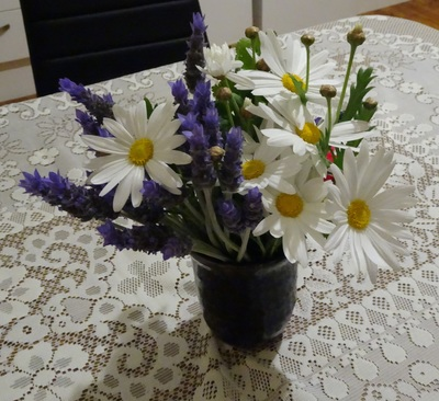 Daisies in wine glass