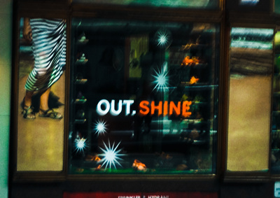 Out shine sign in shoe shop window